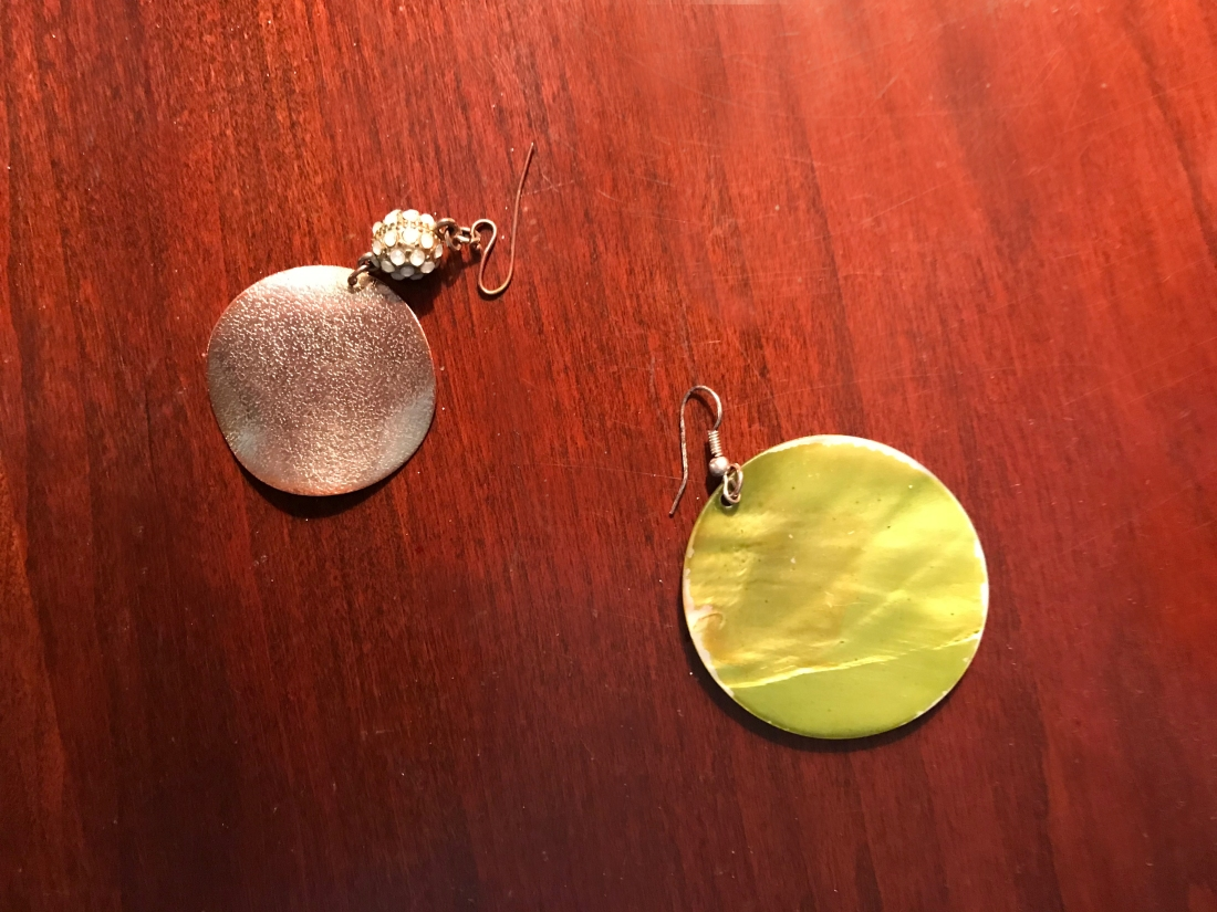 mismatched earrings, green and gold